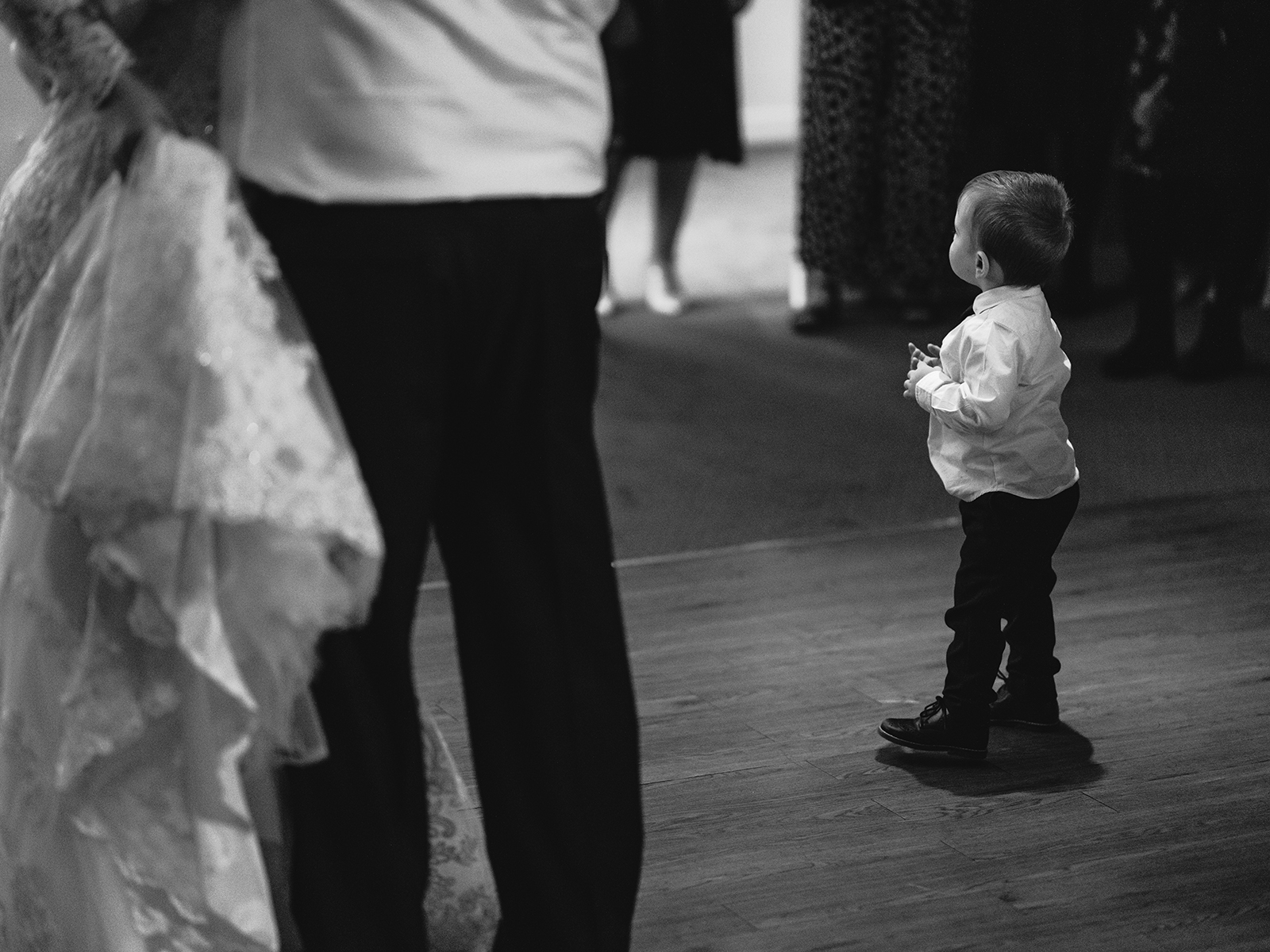 a toddler dancing at a wedding reception
